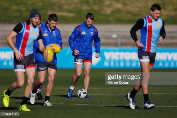 Jake Stringer of the Bulldogs dribbles a soccer ball during a Western Bulldogs AFL training session at Whitten Oval on July 15 2017 in Melbourne...