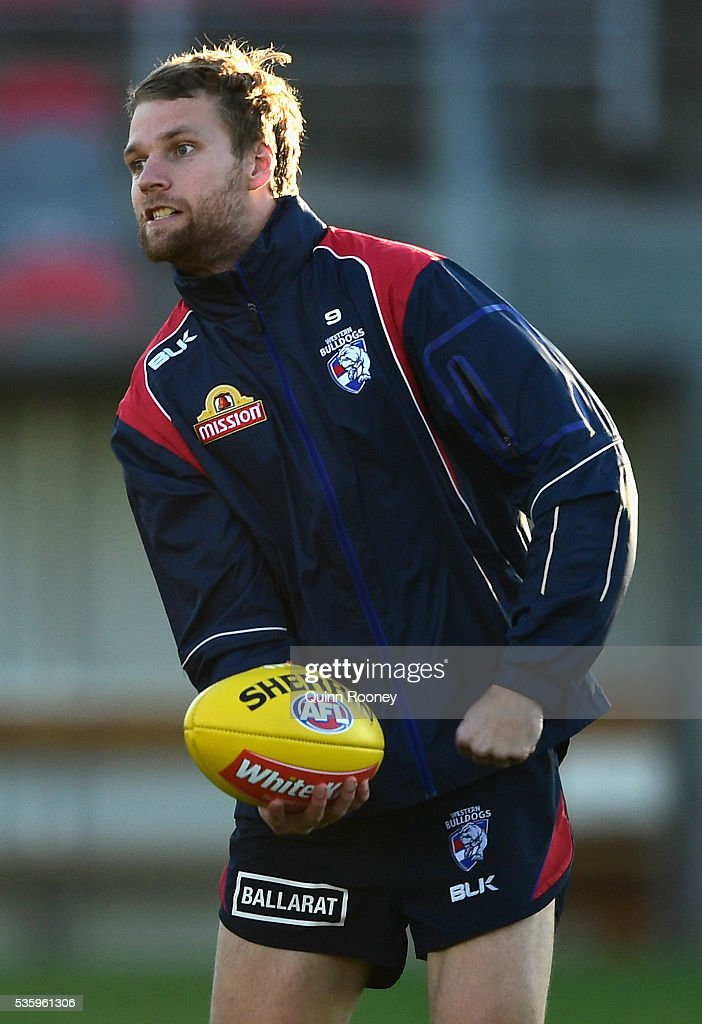Jake Stringer of the Bulldogs handballs during a Western Bulldogs AFL training session at Whitten Oval on May 31, 2016 in Melbourne, Australia.