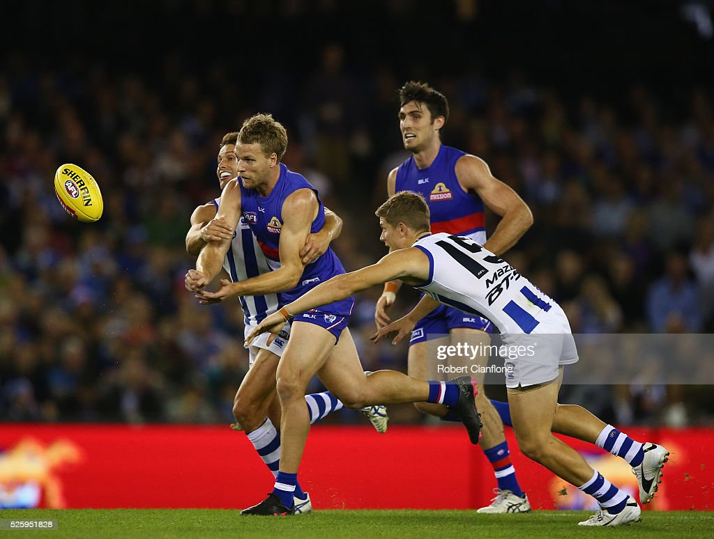 Jake Stringer of the Bulldogs handballs during the round six AFL match between the North Melbourne Kangaroos and the Western Bulldogs at Etihad Stadium on April 29, 2016 in Melbourne, Australia.
