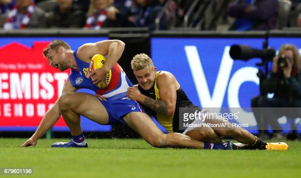 Jake Stringer of the Bulldogs injures his knee as he is tackled by Brandon Ellis of the Tigers during the 2017 AFL round 07 match between the Western...