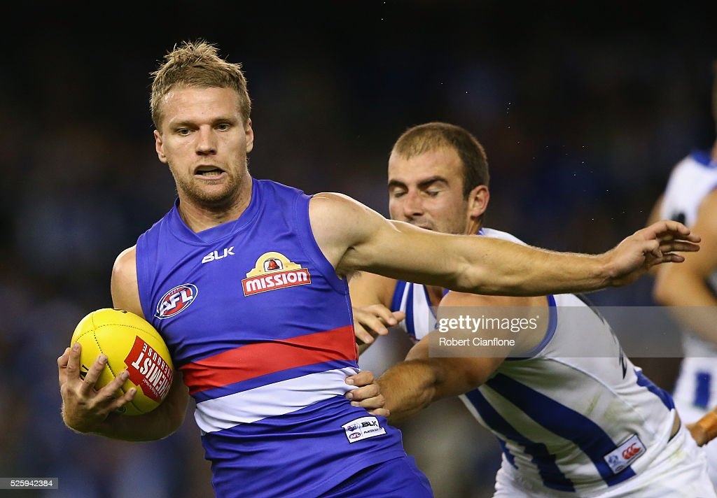 Jake Stringer of the Bulldogs is challenged by Ben Cunnington of the Kangaroos during the round six AFL match between the North Melbourne Kangaroos and the Western Bulldogs at Etihad Stadium on April 29, 2016 in Melbourne, Australia.