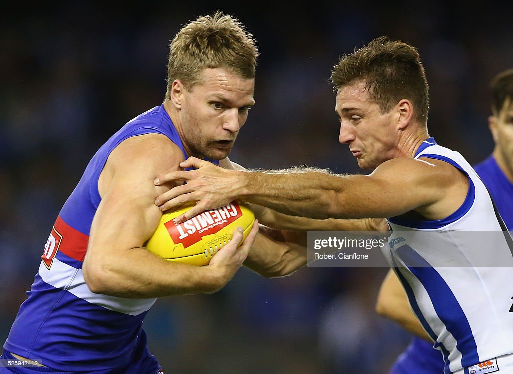 Jake Stringer of the Bulldogs is challenged by Shaun Atley of the Kangaroos during the round six AFL match between the North Melbourne Kangaroos and the Western Bulldogs at Etihad Stadium on April 29, 2016 in Melbourne, Australia.