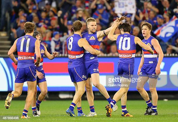 Jake Stringer of the Bulldogs is congratulated by team mates after kicking a goal during the AFL Second Elimination Final match between the Western...