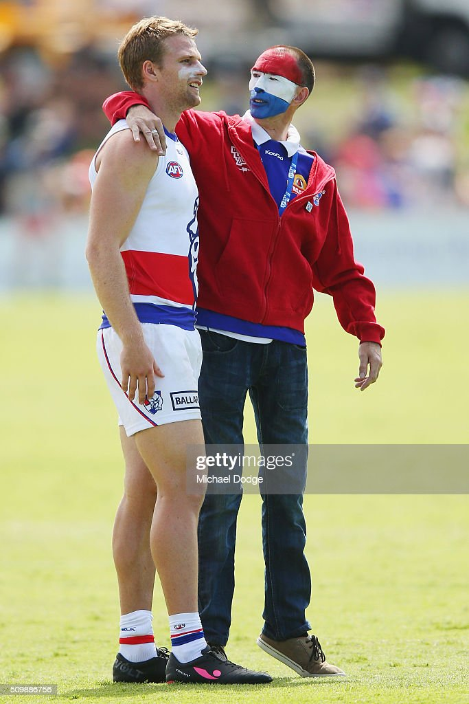 Jake Stringer of the Bulldogs is greeted by fans after the Western Bulldogs AFL intra-club match at Whitten Oval on February 13, 2016 in Melbourne, Australia.
