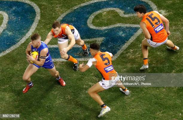 Jake Stringer of the Bulldogs is tackled by Heath Shaw of the Giants during the 2017 AFL round 21 match between the Western Bulldogs and the GWS...