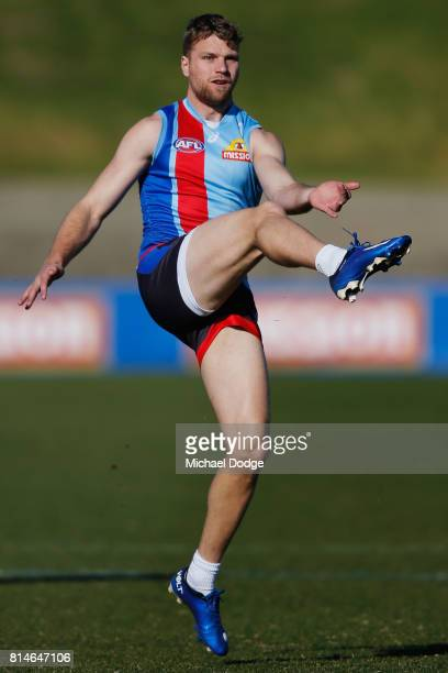 Jake Stringer of the Bulldogs kicks the ball during a Western Bulldogs AFL training session at Whitten Oval on July 15 2017 in Melbourne Australia