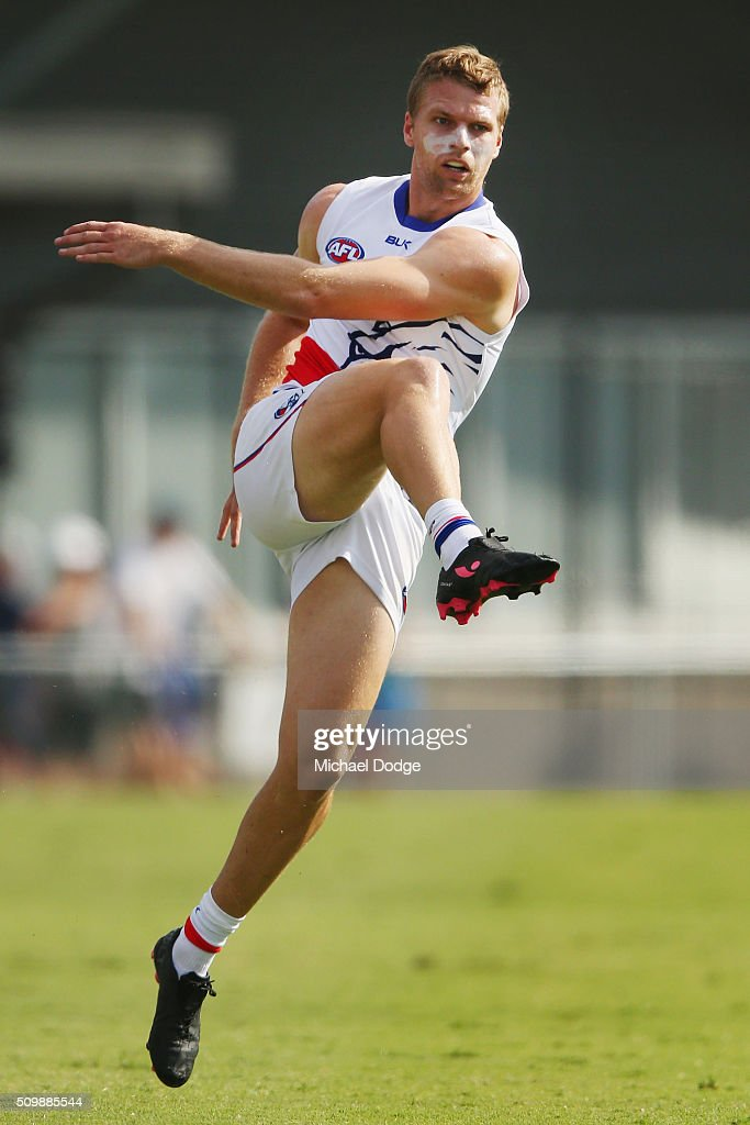 Jake Stringer of the Bulldogs kicks the ball during the Western Bulldogs AFL intra-club match at Whitten Oval on February 13, 2016 in Melbourne, Australia.