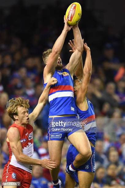 Jake Stringer of the Bulldogs marks infront of Callum Mills of the Swans during the round two AFL match between the Western Bulldogs and the Sydney...