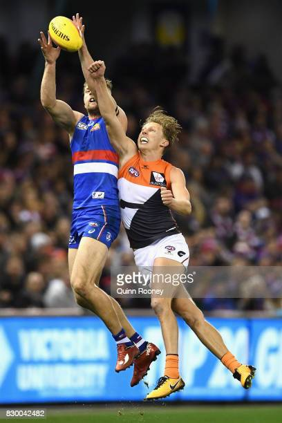 Jake Stringer of the Bulldogs marks infront of Lachie Whitfield of the Giants during the round 21 AFL match between the Western Bulldogs and the...
