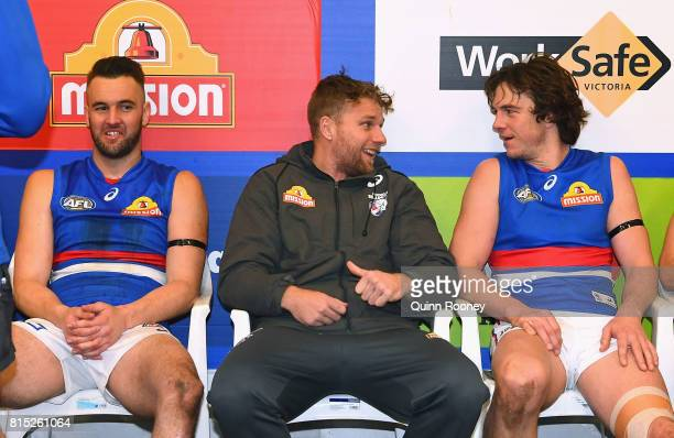 Jake Stringer of the Bulldogs talks to Matthew Suckling and Liam Picken in the rooms during the round 17 AFL match between the Carlton Blues and the...