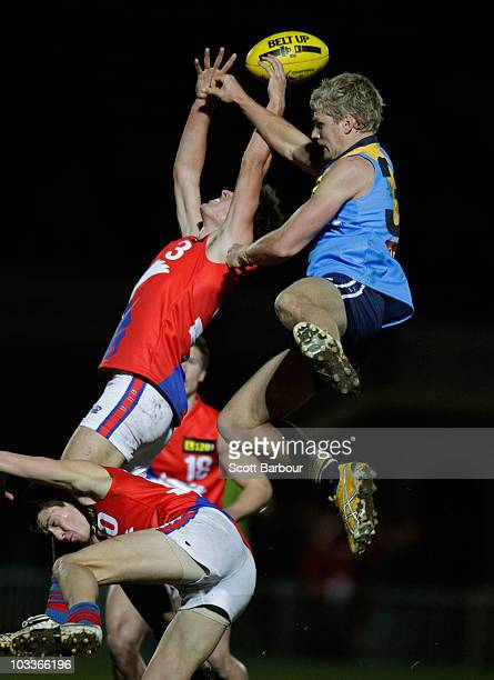 Jake Stringer of the Pioneers and Andrew Gaff of the Chargers compete for the ball during the round 16 TAC Cup match between the Bendigo Pioneers and...