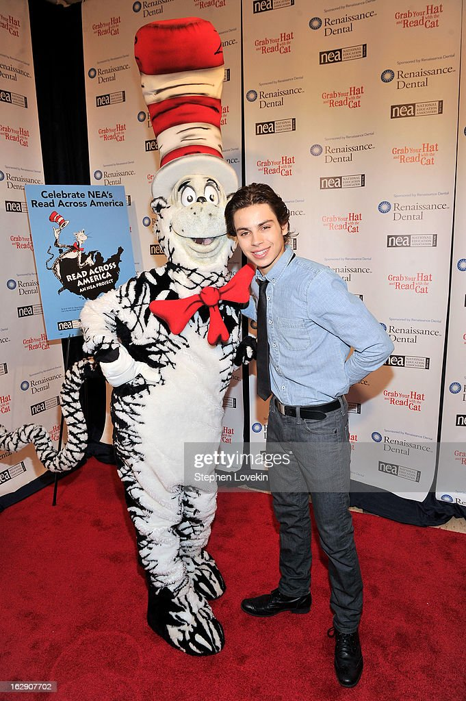 Jake T. Austin Joins Cat In The Hat On NEA's Read Across America Day at New York Public Library on March 1, 2013 in New York City.