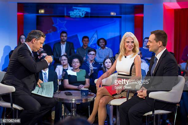 Jake Tapper of CNN's State of the Union on stage with Trump Campaign Manager Kellyanne Conway and Clinton Campaign Manager Robby Mook speak during...