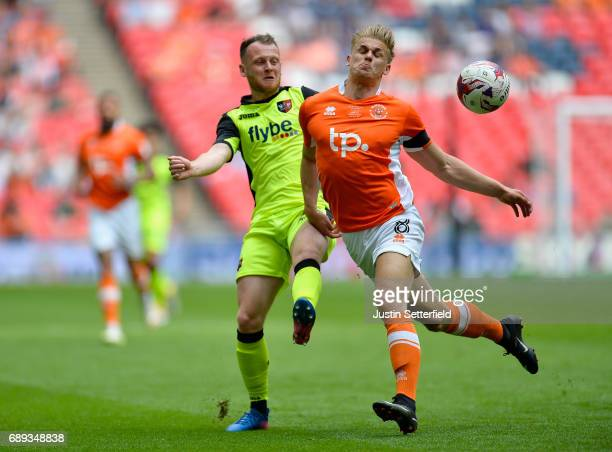 Jake Taylor of Exeter City and Brad Potts of Blackpool battle for possession during the Sky Bet League Two Playoff Final between Blackpool and Exeter...