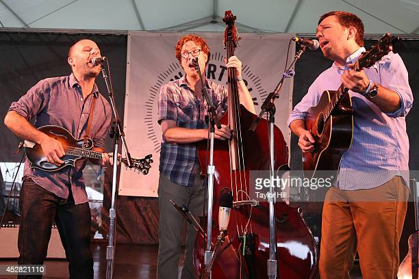 Jake Tilove Ian Riggs and Ed Helms as The Lonesome Trio perform during the 2014 Newport Folk Festival at Fort Adams State Park on July 27 2014 in...