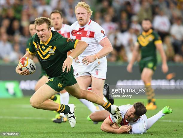Jake Trbojevic of Australia is tackled during the 2017 Rugby League World Cup match between the Australian Kangaroos and England at AAMI Park on...