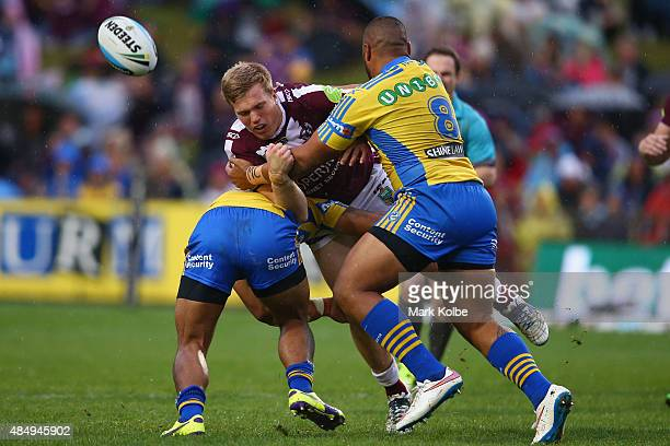 Jake Trbojevic of the Eagles loses the ball as he is tackled during the round 24 NRL match between the Manly Warringah Sea Eagles and the Parramatta...