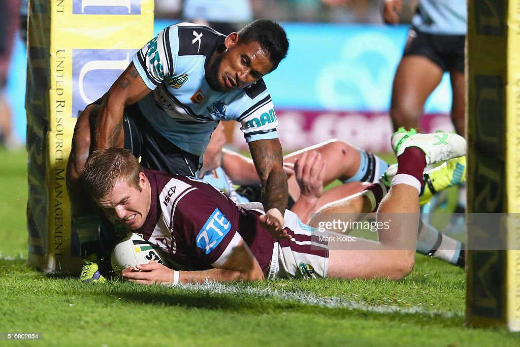 Jake Trbojevic of the Eagles scores a try as he is tackled by Ben Barba of the Sharks during the round three NRL match between the Manly Sea Eagles and the Cronulla Sharks at Brookvale Oval on March 21, 2016 in Sydney, Australia.
