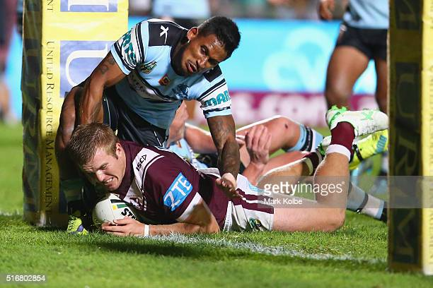Jake Trbojevic of the Eagles scores a try as he is tackled by Ben Barba of the Sharks during the round three NRL match between the Manly Sea Eagles...