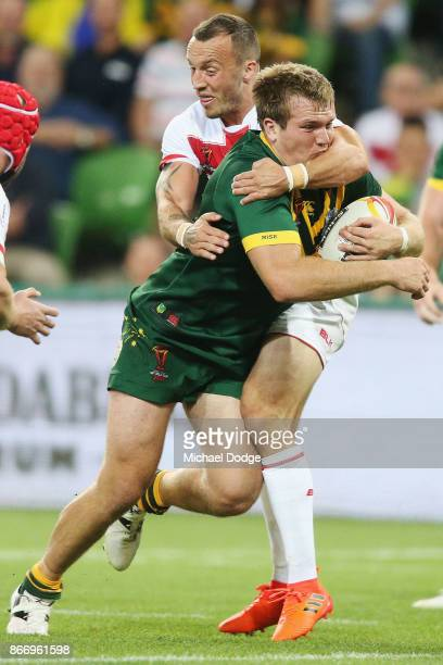 Jake Trbojevic of the Kangaroos is tackled by Josh Hodgson of England during the 2017 Rugby League World Cup match between the Australian Kangaroos...