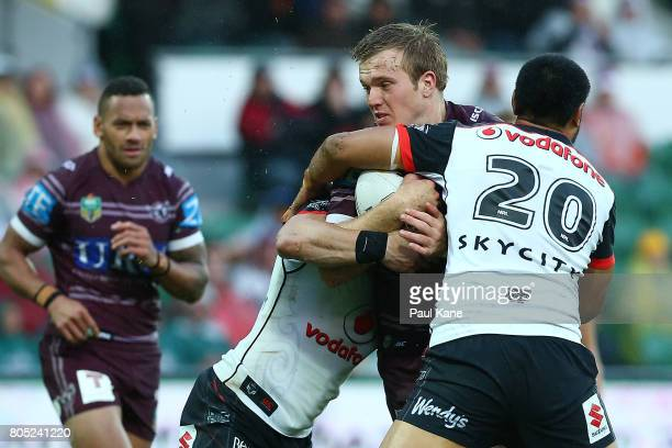 Jake Trbojevic of the Sea Eagles attempts to break thru a tackle during the round 17 NRL match between the Manly Sea Eagles and the New Zealand...