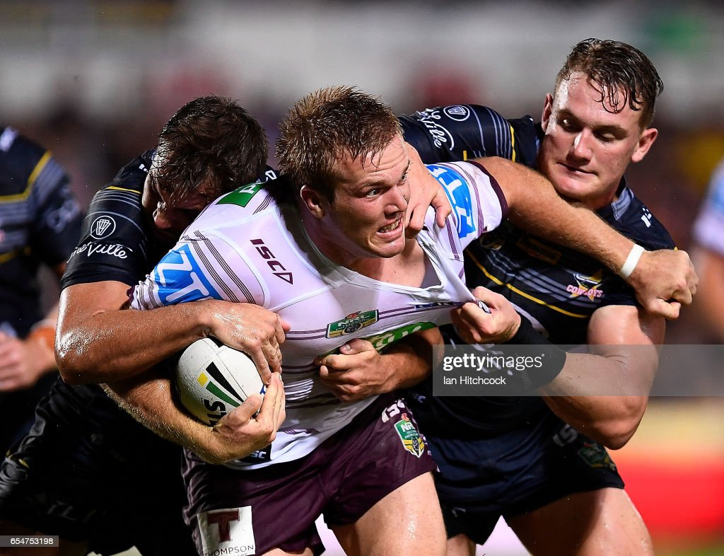 Jake Trbojevic of the Sea Eagles is tackled by Coen Hess and Benjamin Hampton of the Cowboys during the round three NRL match between the North Queensland Cowboys and the Manly Sea Eagles at 1300SMILES Stadium on March 18, 2017 in Townsville, Australia.