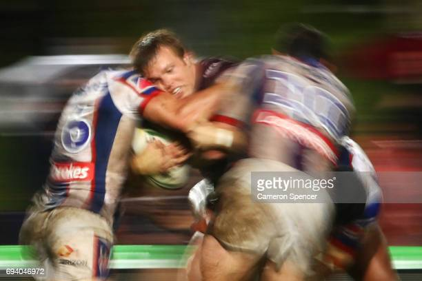 Jake Trbojevic of the Sea Eagles is tackled during the round 14 NRL match between the Manly Sea Eagles and the Newcastle Knights at Lottoland on June...
