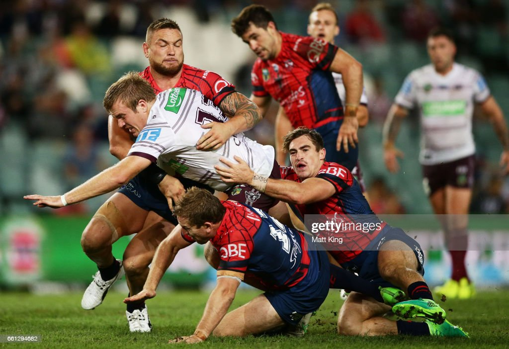Jake Trbojevic of the Sea Eagles is tackled during the round five NRL match between the Sydney Roosters and the Manly Sea Eagles at Allianz Stadium on March 31, 2017 in Sydney, Australia.