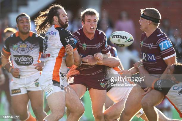 Jake Trbojevic of the Sea Eagles offloads the ball during the round 19 NRL match between the Manly Sea Eagles and the Wests Tigers at Lottoland on...