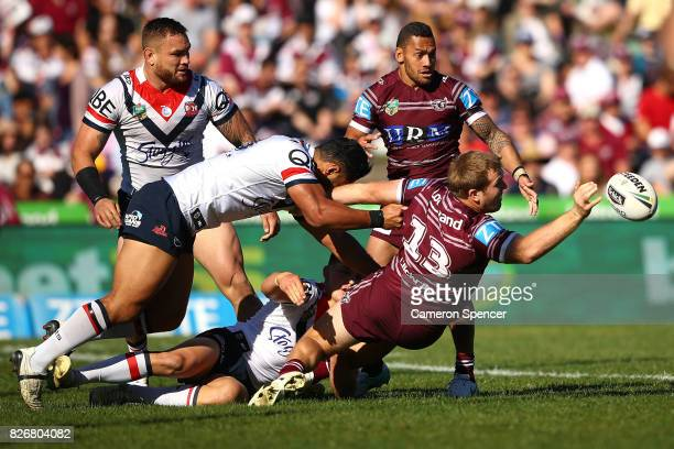 Jake Trbojevic of the Sea Eagles offloads the ball during the round 22 NRL match between the Manly Warringah Sea Eagles and the Sydney Roosters at...