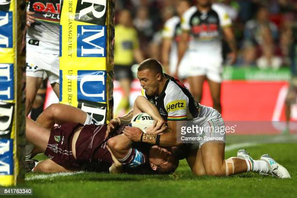 Jake Trbojevic of the Sea Eagles scores a try during the round 26 NRL match between the Manly Sea Eagles and the Penrith Panthers at Lottoland on...