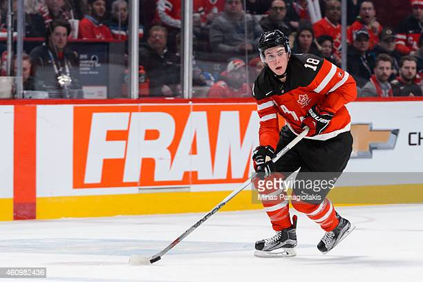 Jake Virtanen of Team Canada looks to play the puck during the 2015 IIHF World Junior Hockey Championship game against Team Finland at the Bell...