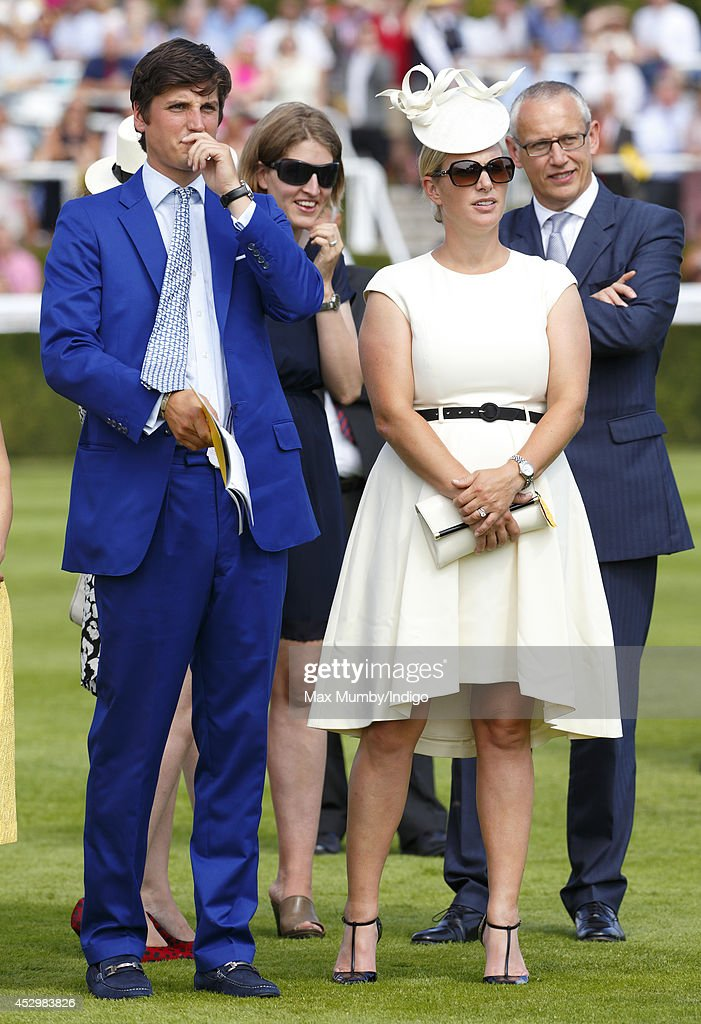 Jake Warren and <a gi-track='captionPersonalityLinkClicked' href=/galleries/search?phrase=Zara+Phillips&family=editorial&specificpeople=161323 ng-click='$event.stopPropagation()'>Zara Phillips</a> watch Queen Elizabeth II's horse Estimate run in the Artemis Goodwood Cup on Ladies Day of Glorious Goodwood at Goodwood Racecourse on July 31, 2014 in Chichester, England.