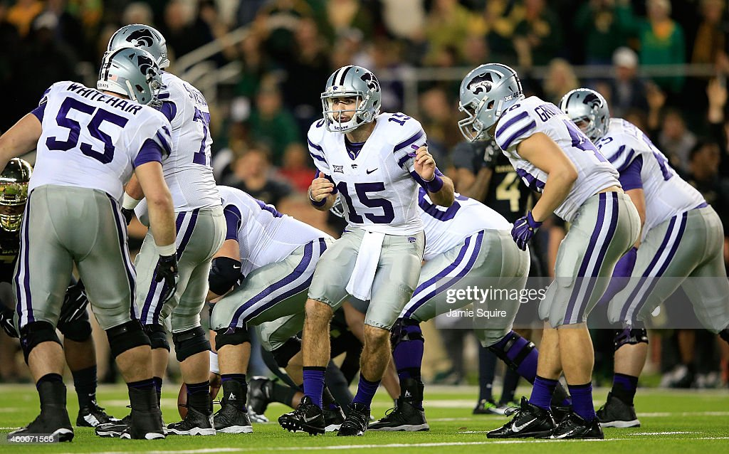 <a gi-track='captionPersonalityLinkClicked' href=/galleries/search?phrase=Jake+Waters&family=editorial&specificpeople=10875996 ng-click='$event.stopPropagation()'>Jake Waters</a> #15 of the Kansas State Wildcats directs the Wildcats offense against the Baylor Bears during the first half of the game on December 6, 2014 at McLane Stadium in Waco, Texas.