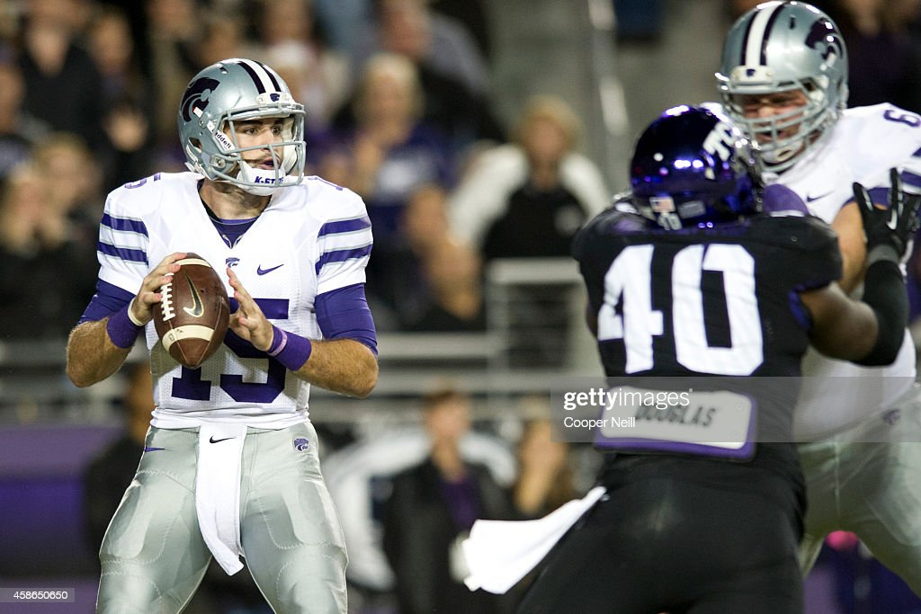<a gi-track='captionPersonalityLinkClicked' href=/galleries/search?phrase=Jake+Waters&family=editorial&specificpeople=10875996 ng-click='$event.stopPropagation()'>Jake Waters</a> #15 of the Kansas State Wildcats drops back to pass against the TCU Horned Frogs during the 1st quarter on November 8, 2014 at Amon G. Carter Stadium in Fort Worth, Texas.