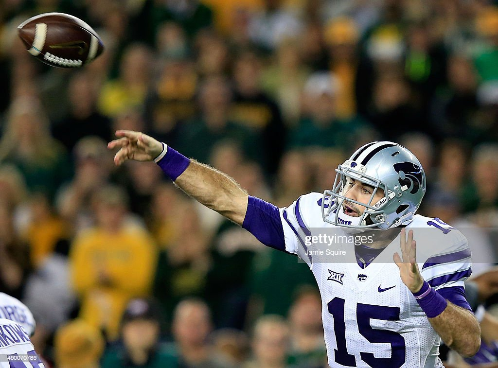 <a gi-track='captionPersonalityLinkClicked' href=/galleries/search?phrase=Jake+Waters&family=editorial&specificpeople=10875996 ng-click='$event.stopPropagation()'>Jake Waters</a> #15 of the Kansas State Wildcats passes against the Baylor Bears during the first half of the game on December 6, 2014 at McLane Stadium in Waco, Texas.