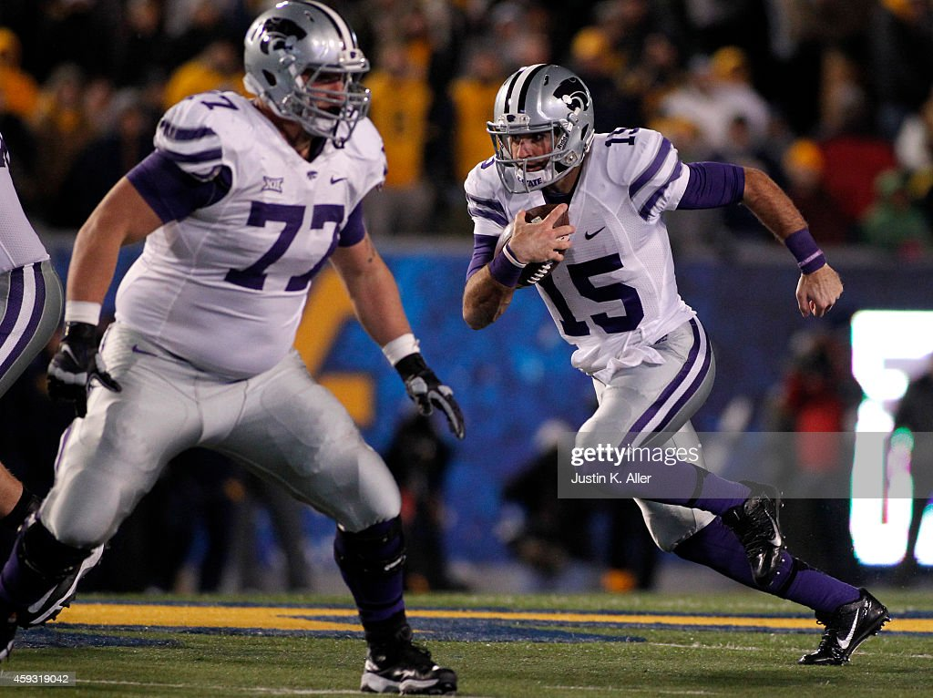 <a gi-track='captionPersonalityLinkClicked' href=/galleries/search?phrase=Jake+Waters&family=editorial&specificpeople=10875996 ng-click='$event.stopPropagation()'>Jake Waters</a> #15 of the Kansas State Wildcats rushes during the game against the West Virginia Mountaineers on November 20, 2014 at Mountaineer Field in Morgantown, West Virginia.