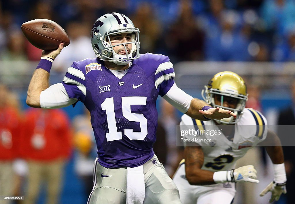 <a gi-track='captionPersonalityLinkClicked' href=/galleries/search?phrase=Jake+Waters&family=editorial&specificpeople=10875996 ng-click='$event.stopPropagation()'>Jake Waters</a> #15 of the Kansas State Wildcats throws the ball against the UCLA Bruins in the first quarter during the Valero Alamo Bowl at Alamodome on January 2, 2015 in San Antonio, Texas.