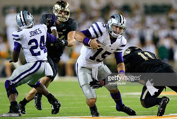Jake Waters of the Kansas State Wildcats tries to elude Taylor Young of the Baylor Bears during the first half of the game on December 6 2014 at...