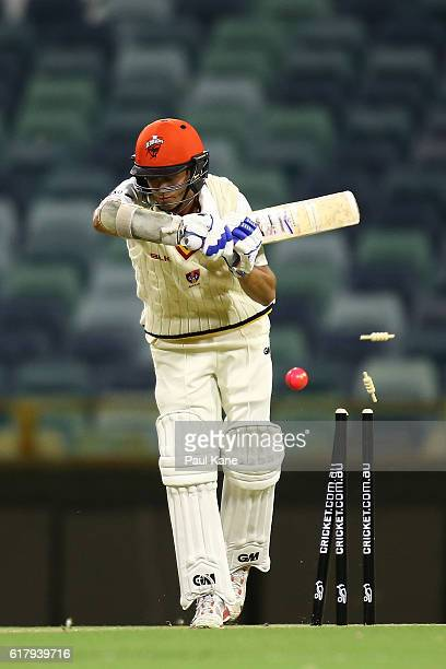 Jake Weatherald of the Redbacks is bowled by Jason Behrendorff of the Warriors during day one of the Sheffield Shield match between Western Australia...