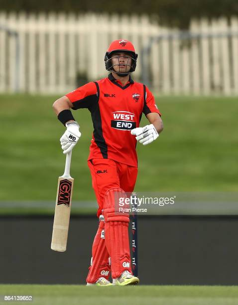 Jake Weatherald of the Redbacks looks dejected after being dismissed by Nathan CoulterNile of the Warriors celebrates during the JLT One Day Cup...