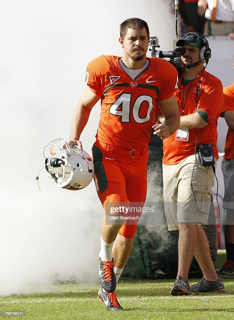 Jake Wieclaw #40 of the Miami Hurricanes is introduced to the crowd during senior day prior to the game against the South Florida Bulls on November 17, 2012 at Sun Life Stadium in Miami Gardens, Florida. The Hurricanes defeated the Bulls 40-9.