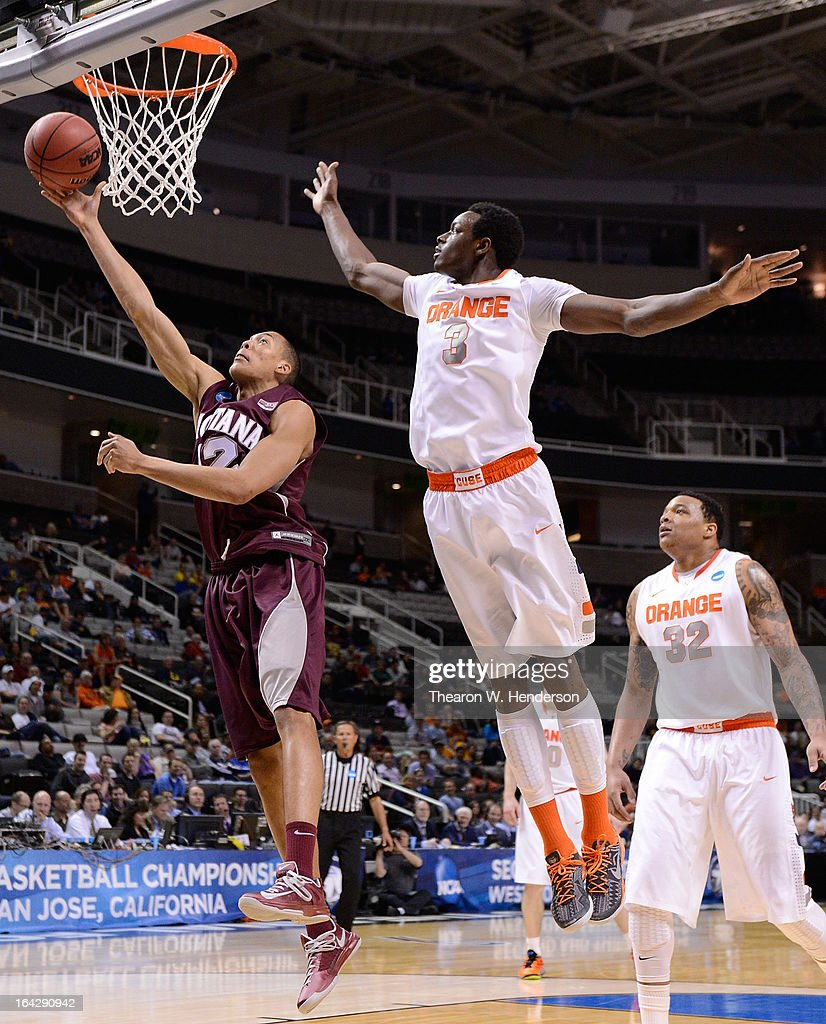 Jake Wiley #12 of the Montana Grizzlies shoots over Jerami Grant #3 of the Syracuse Orange in the second half during the second round of the 2013 NCAA Men's Basketball Tournament at HP Pavilion on March 21, 2013 in San Jose, California.