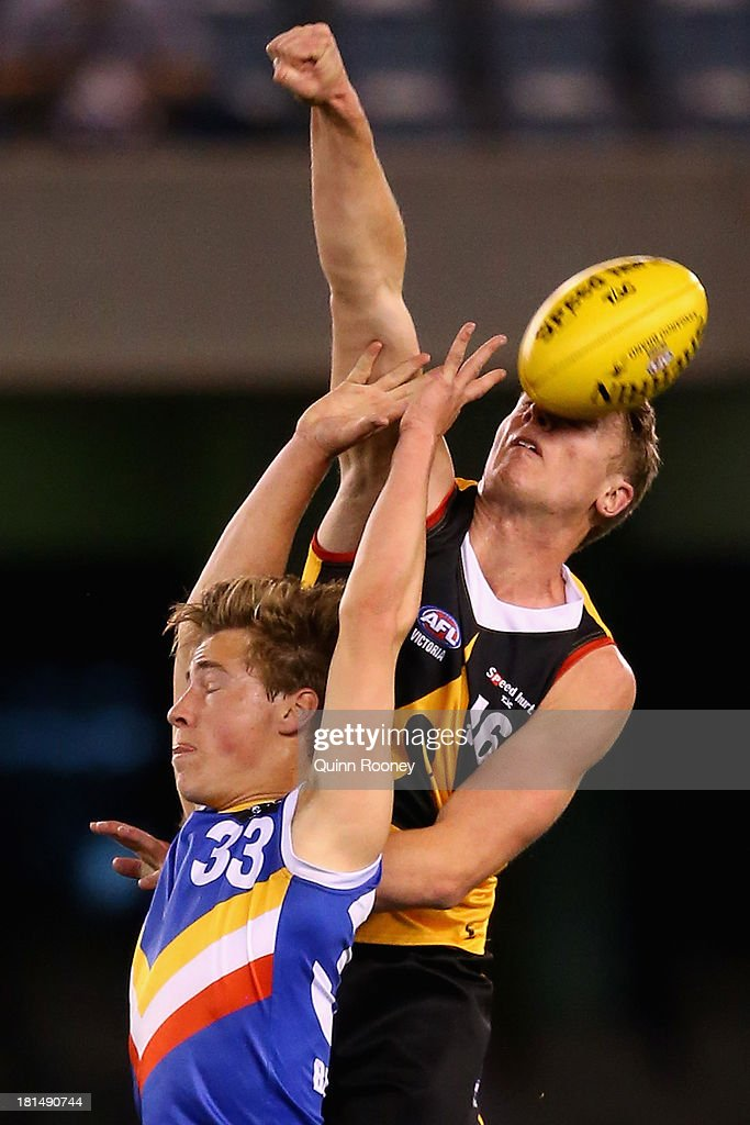 Jake Wilson of the Stingrays spoils a mark by Matthew Traynor of the Ranges during the TAC Cup final match between Eastern Ranges and the Dandenong Southern Stingrays at Etihad Stadium on September 22, 2013 in Melbourne, Australia.