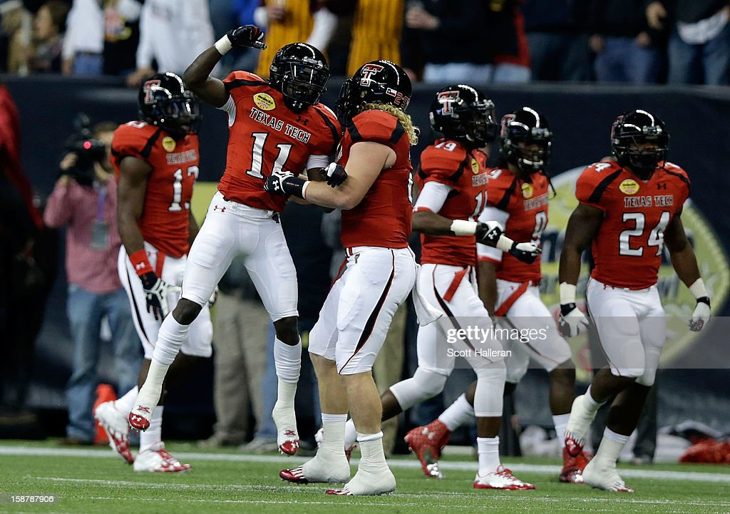 Jakeem Grant #11 of Texas Tech celebrates after his 99-yard kickoff return for a first quarter touchdown against Minnesota during the Meineke Car Care of Texas Bowl at Reliant Stadium on December 28, 2012 in Houston, Texas.