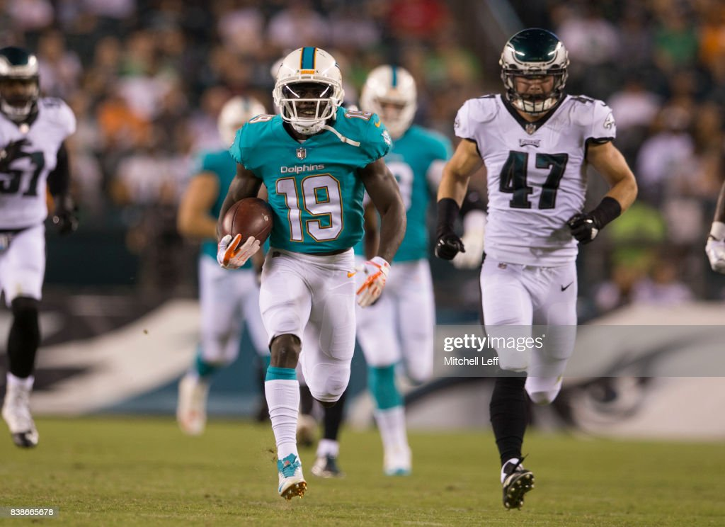 Jakeem Grant #19 of the Miami Dolphins runs past Nathan Gerry #47 of the Philadelphia Eagles to score a touchdown in the third quarter in the preseason game at Lincoln Financial Field on August 24, 2017 in Philadelphia, Pennsylvania. The Eagles defeated the Dolphins 38-31.