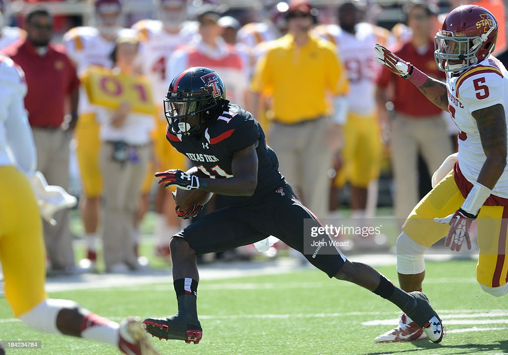 Jakeem Grant #11 of the Texas Tech Red Raiders is being chased by Jacques Washington #5 of the Iowa State Cyclones during game action on October 12, 2013 at AT&T Jones Stadium in Lubbock, Texas. Texas Tech won the game over Iowa State 42-35.