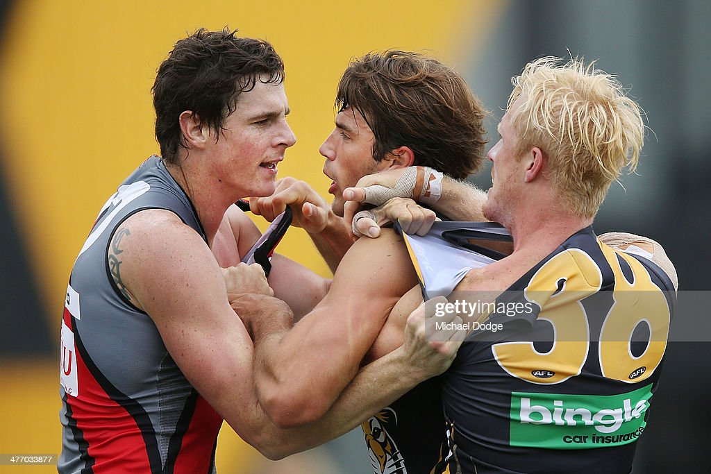 Jaker Carlisle (L) of the Bombers fights with Alex Rance and Steven Morris of the Tigers during an AFL Practice Match between the Richmond Tigers and the Essendon Bombers at Punt Road Oval on March 7, 2014 in Melbourne, Australia.
