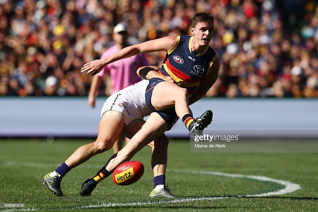 Jaker Lever of the Crows is tackled while trying to kick the ball during the round six AFL match between the Adelaide Crows and the Fremantle Dockers at Adelaide Oval on April 30, 2016 in Adelaide, Australia.