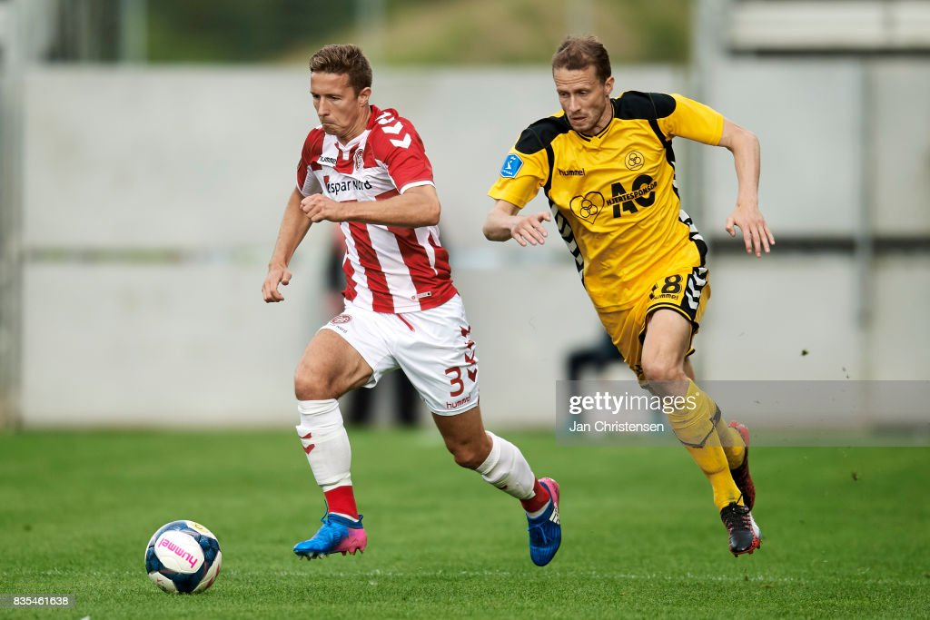 Jakob Ahlmann of AaB Aalborg and Jeppe Mehl of AC Horsens in action during the Danish Alka Superliga match between AC Horsens and AaB Aalborg at Casa Arena Horsens on August 18, 2017 in Horsens, Denmark.